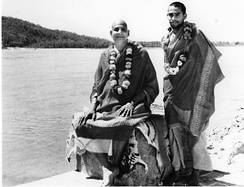 With Sivananda (seated on tiger skin) by the Ganges, c. 1950