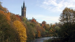 The university's tower overlooking Kelvingrove Park, as seen from Partick Bridge over the River Kelvin