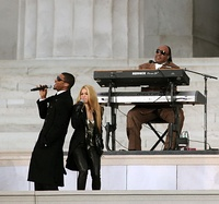 "Shakira performing with Stevie Wonder and Usher ""Higher Ground"" during Obama's inauguration in 2009 ( left), Wyclef Jean (right) was the main writer and contributor to the song ""Hips Don't Lie"" in 2006 to launch the re-edition of Oral Fixation Vol. 2 and later in the Jean song King and Queen."