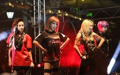 2NE1 holding a concert in Clarke Quay, Singapore.