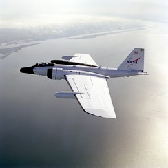 A WB-57F flies over the Gulf of Mexico near its base at NASA JSC.