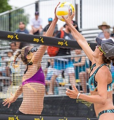 "Two opposing players simultaneously contact the ball above the net with open hands, known as a ""joust"". The receiving team is entitled to another three contacts.[40]"