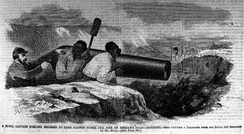 An 1862 illustration of a Confederate officer forcing slaves at gunpoint to fire a cannon at U.S. soldiers in battle. A similar instance occurred at the first Battle of Bull Run, where slaves were forced by the Confederates to load and fire a cannon at U.S. forces.[75][76]
