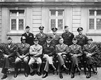 Senior American commanders of the European theater of World War II.   *Seated are (from left to right) Gens. William H. Simpson, George S. Patton, Carl A. Spaatz, Dwight D. Eisenhower, Omar Bradley, Courtney H. Hodges, and Leonard T. Gerow; *standing are (from left to right) Gens. Ralph F. Stearley, Hoyt Vandenberg, Walter Bedell Smith, Otto P. Weyland, and Richard E. Nugent.