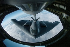 A B-2 Spirit bomber from the 509th Bomb Wing, Whiteman AFB, Missouri refuels from a KC-135 Stratotanker