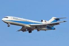 The 727-200 (here from Ariana Afghan Airlines) is 20 ft (6.1 m) longer.