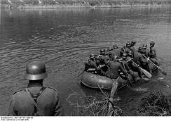 German soldiers crossing the Meuse in an inflatable assault boat during the Second World War