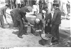 Local Jews forced by the Germans to sweep streets, June 1941
