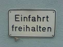 A sign in an older version of DIN Mittelschrift. Note the different structure of the 'a' and how curved strokes do not thin as they connect, as at the join of the 'h'.