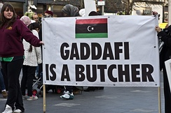 An anti-Gaddafist placard being displayed by demonstrators in Ireland in 2011