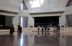 While standing inside The Hall of Remembrance, located within the United States Holocaust Memorial Museum, a volunteer reads the names of Holocaust victims during the Days of Remembrance of the Victims of the Holocaust.