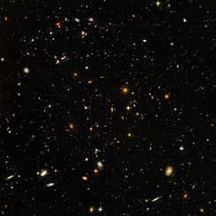 This high-resolution image of the Hubble Ultra Deep Field includes galaxies of various ages, sizes, shapes, and colors. The smallest, reddest galaxies, are some of the most distant galaxies to have been imaged by an optical telescope.