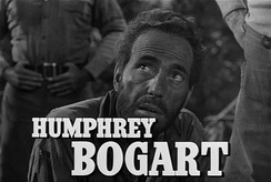 Bogart looking up, with his name on the screen