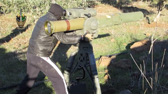 A member of the Free Syrian Army – Southern Front's Sword of al-Sham Brigades prepares to launch a BGM-71E TOW at a Syrian Arab Army position in southern Syria (December 2014)