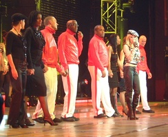 Minogue and her troupe during the end of the Money Can't Buy concert, at London's Hammersmith Apollo