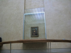 Mona Lisa behind bulletproof glass at the Louvre Museum