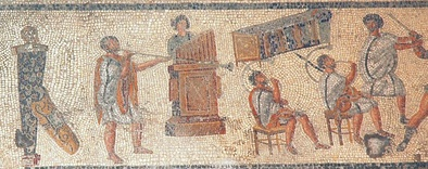 Musicians in a detail from the Zliten mosaic (2nd century AD), originally shown as accompanying gladiator combat and wild-animal events in the arena: from left, the tuba, hydraulis (water pipe organ), and two cornua