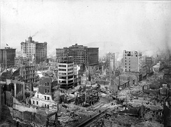 A historical image of damaged and destroyed buildings after the 1906 earthquake in San Francisco