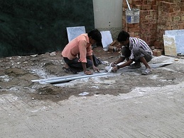 Workers cutting marble without any protective gear, Indore, India