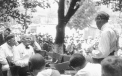At the Scopes Trial, William Jennings Bryan (seated, left) being questioned by Clarence Darrow (standing, right).