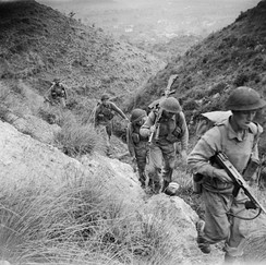 Men of the 10th Battalion, Royal Berkshire Regiment, part of 168th Brigade of British 56th Division, climbing the heights of Calvi Risorta shortly after the invasion of Italy, October 1943.