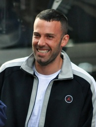 Ben Affleck, wearing a tracksuit top, smiles