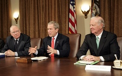 Lee H. Hamilton (left) and James Baker (right) present the Iraq Study Group Report to George W. Bush on 6 December 2006.