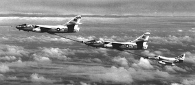 Two A-3 Skywarriors and an A-4 Skyhawk performing a stunt refueling in 1964. Normally, only two planes are used for in-flight refueling.