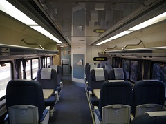 "Lower-level seating on a ""Pacific Business Class"" car in 2012"