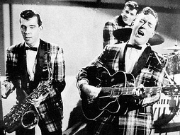Bill Haley and his Comets performing in the 1954 Universal International film Round Up of Rhythm
