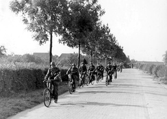 SS troops advancing on bicycles