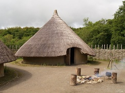 A reconstructed roundhouse and ráth at Craggaunowen, County Clare