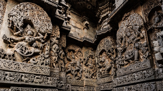 Exterior wall reliefs at Hoysaleswara Temple. The temple was twice sacked and plundered by the Delhi Sultanate.[334]
