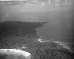USAF reconnaissance photo of Koh Tang, showing East Beach and two downed CH-53s (left) and West Beach (right)