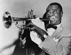 Short-haired black man in his fifties blowing into a trumpet. He is wearing a light-colored sport coat, a white shirt and a bow tie. He is faced left with his eyes looking upwards. His right hand is fingering the trumpet, with the index finger down and three fingers pointing upwards. The man's left hand is mostly covered with a handkerchief and it has a shining ring on the little finger. He is wearing a wristwatch on the left wrist.