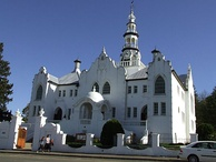 Cape Dutch style-influenced eclectic building of the Nederduitse Gereformeerde Kerk in Swellendam. The Cape Dutch architecture, along with Afrikaans language and Afrikaans literature, is among the lasting legacy of the VOC-era Afrikaans culture in South Africa.