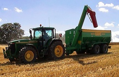 Agriculture production, pictured is a tractor and a chaser bin
