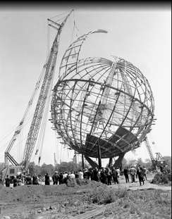 A crane eases the last segment of the Unisphere into place to complete the structure