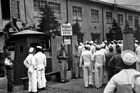 U.S. servicemen entering Recreation and Amusement Association during Occupation of Japan.