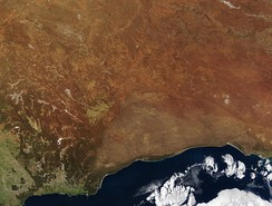 NASA - Visible Earth, the Great Victoria Desert is in the center of the image, north of the Nullarbor Plain.