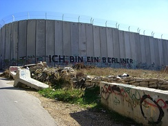 "Graffiti on the road to Bethlehem in the West Bank stating ""Ich bin ein Berliner"""