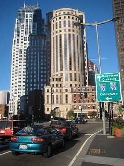Signs in the Financial District of Boston point toward Downtown Crossing, Chinatown, Interstate 93, and Interstate 90.