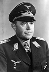 Head-and-shoulders portrait of a uniformed Nazi German air force general in his 50s wearing an Iron Cross.