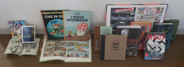 A comparison of book formats for comics around the world.  The left group is from Japan and shows the tankōbon and the smaller bunkobon formats. Those in the middle group of Franco-Belgian comics are in the standard A4-size comic album format. The right group of graphic novels is from English-speaking countries, where there is no standard format.