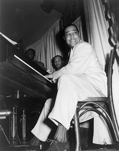 Duke Ellington straddled the big band and bebop genres. Ellington extensively used the blues form.[128]