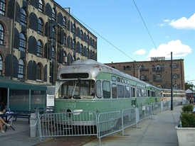 Old, out-of-service streetcars behind a Fairway Market in Red Hook.