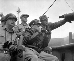 General Douglas MacArthur, UN Command CiC (seated), observes the naval shelling of Incheon from USS Mount McKinley, 15 September 1950