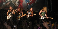 Iron Maiden is a six-part band with a lead vocalist, three guitarists, a bassist, and drummer lineup. (Not shown in this image are Bruce Dickinson and Nicko McBrain.)