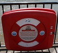 A containered lifebuoy by the River Thames