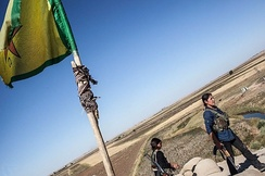 Female Kurdish fighters manning a checkpoint near Ras al-Ayn.